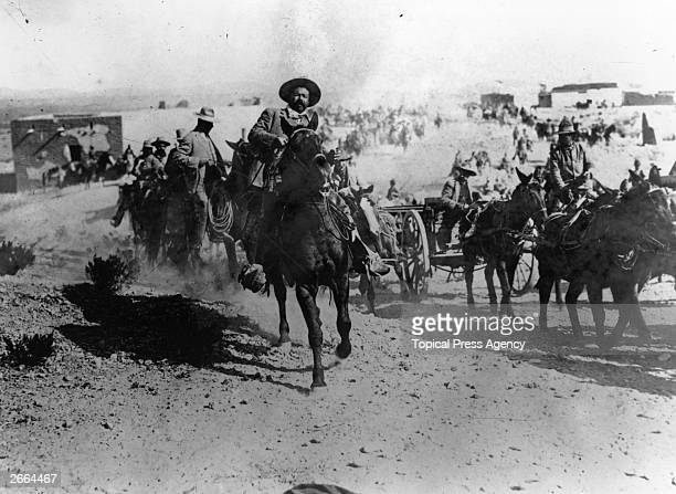 Mexican revolutionary leader General Pancho Villa rides at the head of the Mexican rebels during the Mexican Revolution