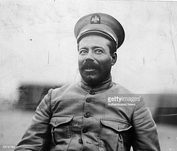 Mexican revolutionary Pancho Villa smiles outdoors wearing a new military uniform 1914