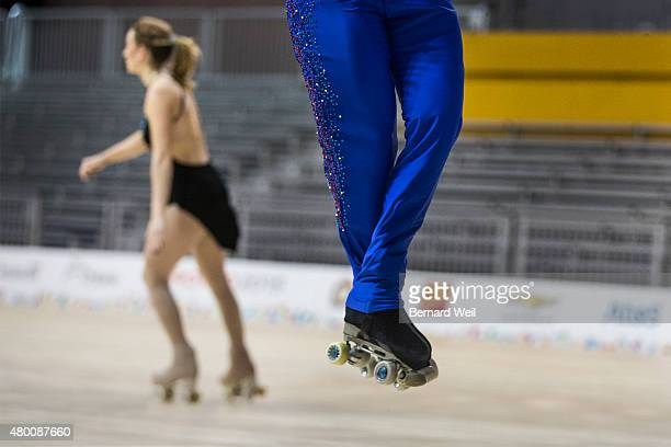 TORONTO ON JULY 9 Mexican Roller figure skater Luis Reyna gets airborne as he practices his routine during a training session as Canadian Kailah...
