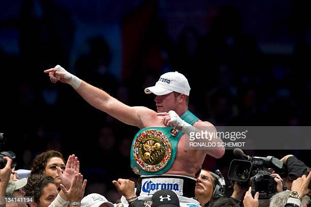 Mexican Saul Canelo Alvarez celebrates after beating Puerto Rican boxer Kermit Cintron for the World Boxing Council SuperWelterweight Championship in...