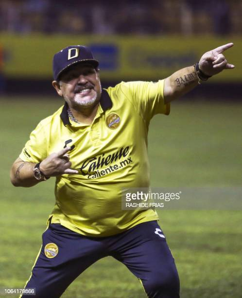 TOPSHOT Mexican second division football club Dorados' Argentine coach Diego Armando Maradona gestures before a match against Bravos de Juarez at the...