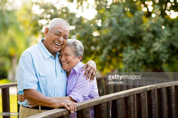 Mexican senior couple laughing on bridge