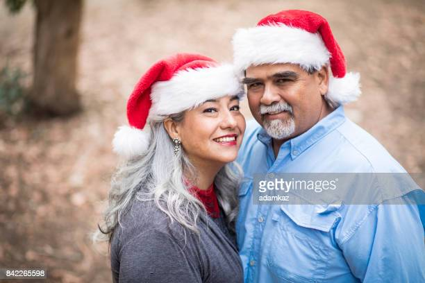 mexican senior portraits with santa hats - mexican christmas stock photos and pictures