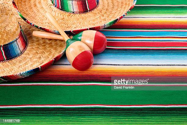 mexican serape blanket, maracas and sombreros - maraca stock photos and pictures