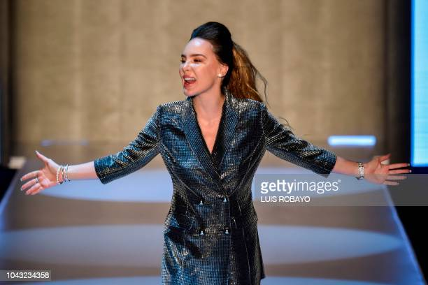 Mexican singer and actress Belinda smiles after presenting her collection 'Pop Star' made in collaboration with the Colombian brand Studio F during...