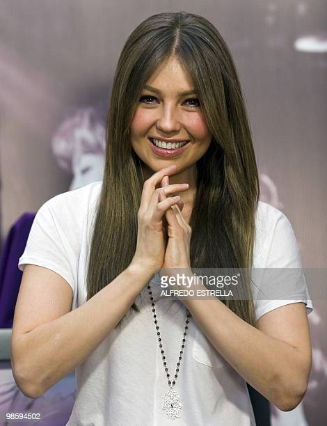 """Mexican singer and actress Thalia, poses for photographers during the presentation of her new disc """"Primera Fila"""" in Mexico City, on April 21, 2010...."""