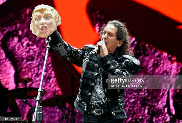 Mexican singer and composer Alex Lora of the band El Tri shows a mask of US President Donald Trump as he performs during the second day of the 'Vive...