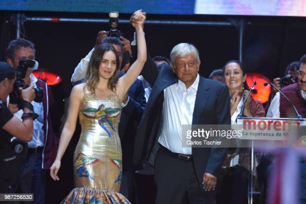 Mexican singer Belinda and presidential candidate Andres Manuel Lopez Obrador wave during the final event of the 2018 Presidential Campaign at Azteca...