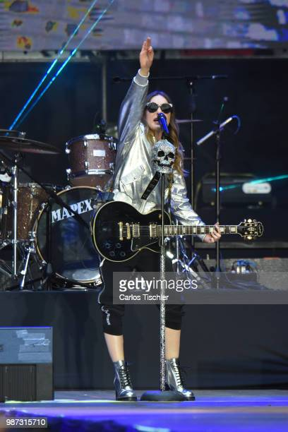 Mexican singer Belinda performs during Andres Manuel Lopez Obrador final event of the 2018 Presidential Campaign at Azteca Stadium on June 27 2018 in...