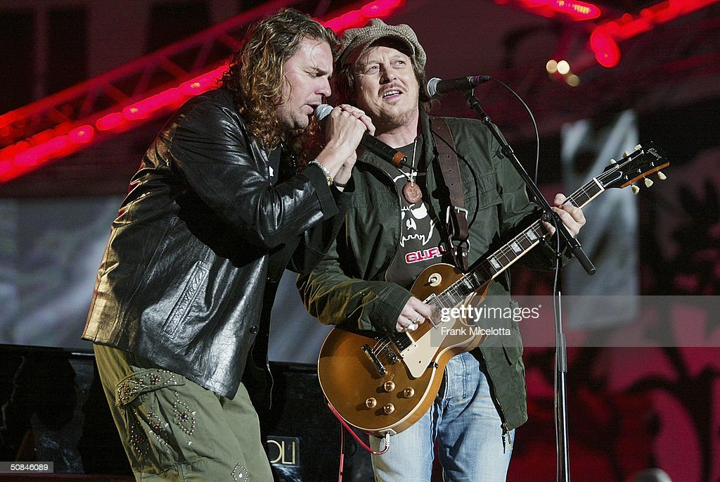 Mexican singer Fher of Mana (L) and Italian musician Zucchero perform on stage at the 'We are the Future' all-star humanitarian concert May 16, 2004 at Circus Maximus in Rome, Italy. The show is being broadcast globally on MTV and will raise money to open child centers in the most war torn regions of the world.