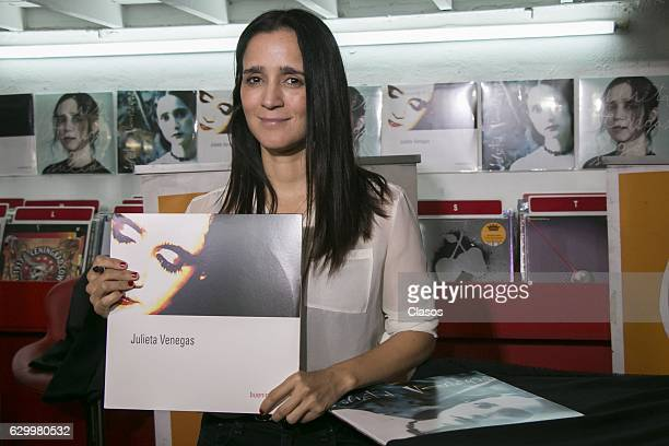 Mexican Singer Julieta Venegas signs autographs for fans during the promotion of his new album 'Vinil' at Roma Records store on December 14 2016 in...