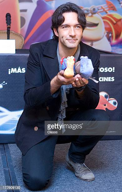 Mexican singer Leonardo De Lozanne poses with the characters during a press conference to present the movie Turbo on July 5, 2013 in Mexico City,...