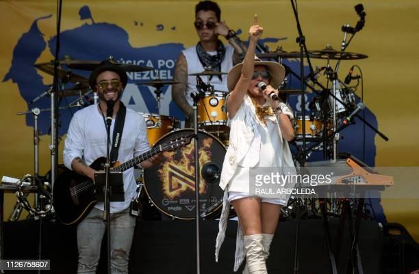 Mexican singer Paulina Rubio performs during Venezuela Aid Live concert organized to raise money for the Venezuelan relief effort at Tienditas...