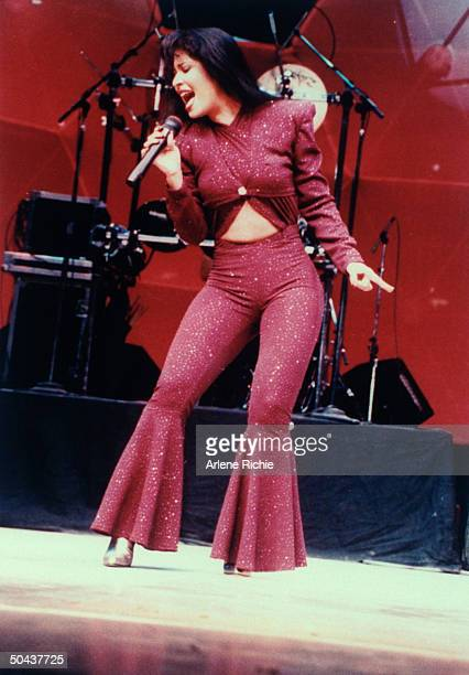 Mexican singer Selena performing in concert one month later she would be shot and killed by Yolanda Saldivar the pres of her fan club after...