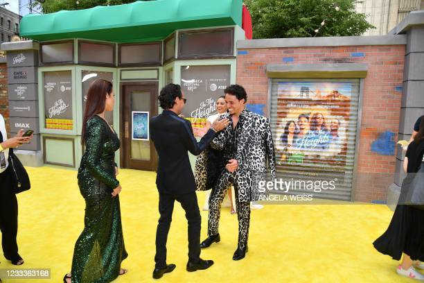"""Mexican singer-songwriter Marc Anthony and US actor Anthony Ramos greet each other at the opening night premiere of """"In The Heights"""" during the..."""