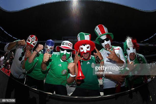 Mexican soccer fans cheer for their team during the FIFA World Cup Qualifying soccer match between the USA and Mexico at Azteco Stadium August 12,...