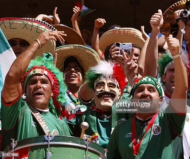 Mexican soccer fans cheer their team during the Group G first round match Croatia/Mexico of the 2002 FIFA World Cup in Korea and Japan, 03 June 2001...