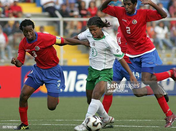 Mexican soccer player Giovanni Dos Santos fights for the ball with Costa Rican Rudy Dawson and Dave Myrie 25 September, 2005 at the Miguel Grau...