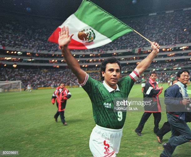 Mexican soccer player Hugo Sanchez waves to fans while carrying the Mexican flag as he concludes his career in a friendly game against Paraguay 18...
