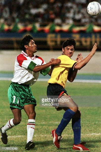 Mexican soccer player Omar Avilan fights for the ball with Reinaldo Melo from Venezuela 21 August during the soccer finals of the Central American...