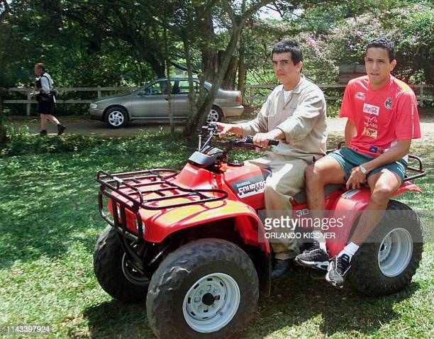 Mexican soccer player Ramon Morales is gets a ride in a 4X4 car 13 July 2001 during a break from his training session at a country club in Cali...