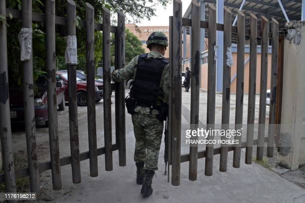 A Mexican soldier enters the regional prosecutor's office in Tepochica Iguala municipality Guerrero state Mexico on October 16 2019 14 civilians and...
