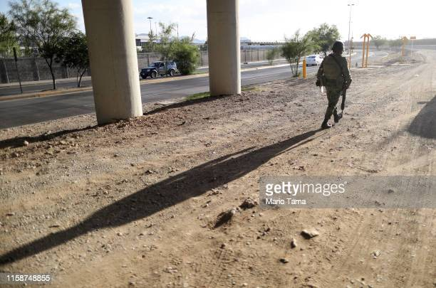 Mexican soldier keeps watch on the Mexican side of the USMexico border on June 27 in Ciudad Juarez Mexico The Mexican government has deployed15000...
