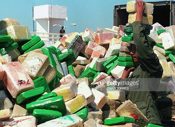 Mexican soldier piles 29 April one to twokilo bricks of cocaine before burning them in Matamoros at the border with the US The drug was confiscated...