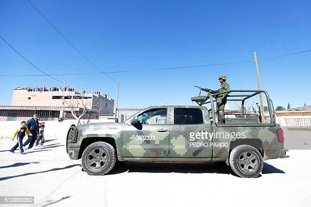 A Mexican soldier stands guard near a prison following the visit by Pope Francis in Ciudad Juarez Chihuahua State Mexico on February 17 2016 The...