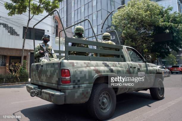 Mexican soldiers attached to the National Guard patrol Mexico City on April 16 amid the COVID19 coronavirus pandemic
