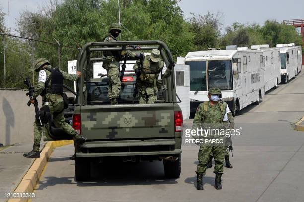 Mexican soldiers attached to the National Guard patrol outside the Belisario Dominguez Hospital which is serving Covid19 patients in Mexico City on...