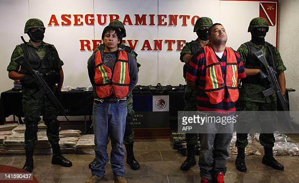 """Mexican soldiers escort Oscar Pozos Jimenez and Jose Serna Padilla aka """"El zopilote"""" an alleged member of the drug cartel """"Cartel de Jalisco Nueva..."""