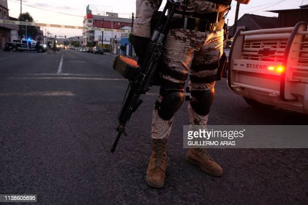 TOPSHOT Mexican Soldiers guard a crime scene where a man was killed by gun fire in downtown Tijuana Baja California state Mexico on April 21 2019...