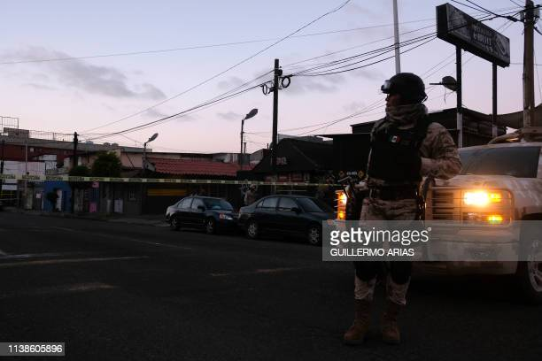 Mexican Soldiers guard a crime scene where a man was killed by gun fire in downtown Tijuana Baja California state Mexico on April 21 2019 Violence in...