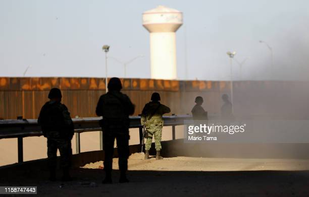 Mexican soldiers keep watch on the Mexican side of the USMexico border on June 27 in Ciudad Juarez Mexico The Mexican government has deployed15000...