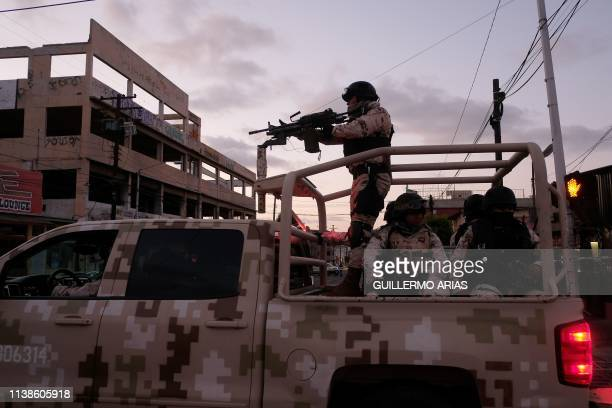 Mexican Soldiers leave the scene of a crime where a man was killed by gun fire in downtown Tijuana Baja California state Mexico on April 21 2019...