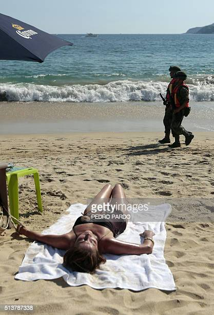Mexican soldiers patrol a beach at the Bay of Santa Lucia in Acapulco Guerrero state Mexico after an increase of violence in the tourist area of this...