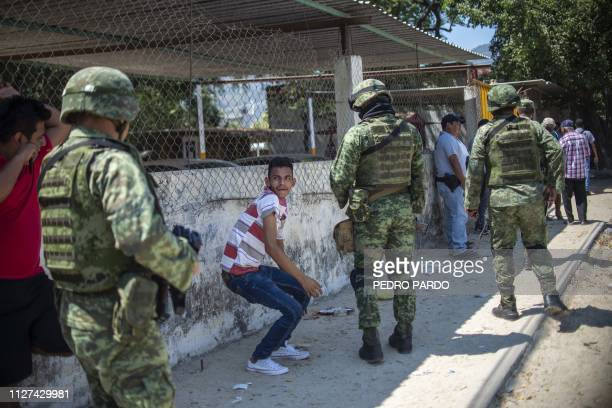 Mexican soldiers patrol the streets of Acapulco, Guerrero State, on February 25, 2019. - Mexican lawmakers reached an agreement last week to approve...