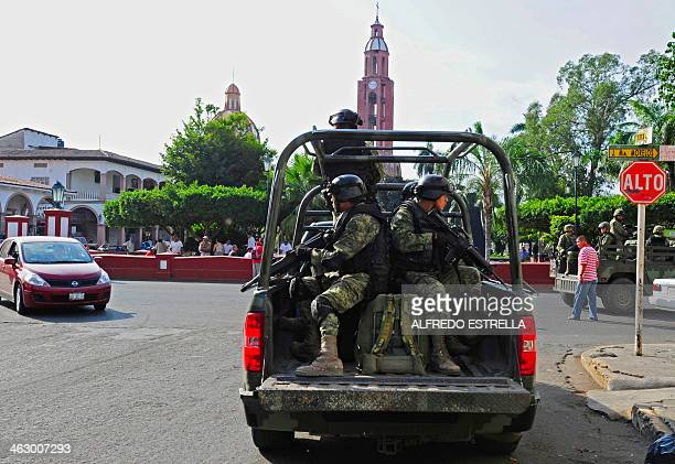 Mexican soldiers patrol the streets of Apatzingan in Michoacan State Mexico on January 16 2014 On the eve federal police and army troops said they...