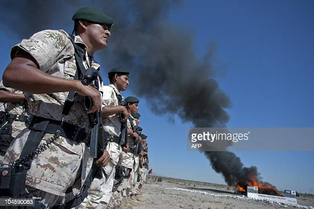 Mexican soldiers stand guard as marijuana cocaine heorine and other drugs are incinerated on September 30 in Ciudad Juarez Chihuahua State Mexico AFP...