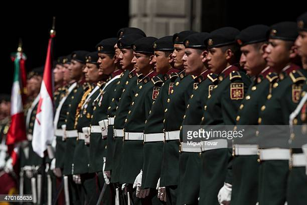 Mexican soldiers stand guard during the welcome ceremony of Canadian Prime Minister Stephen Harper at the National Palace on February 18, 2014 in...
