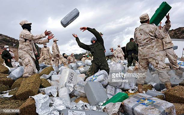 Mexican soldiers unload bundles of seized marijuana before incinerating the drugs at a military base in Tijuana Mexico on Wednesday Oct 20 2010...