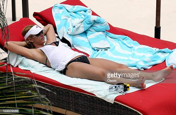 Mexican sports reporter Ines Sainz enjoy sunny days with her family on August 1 2010 in Cancun Mexico