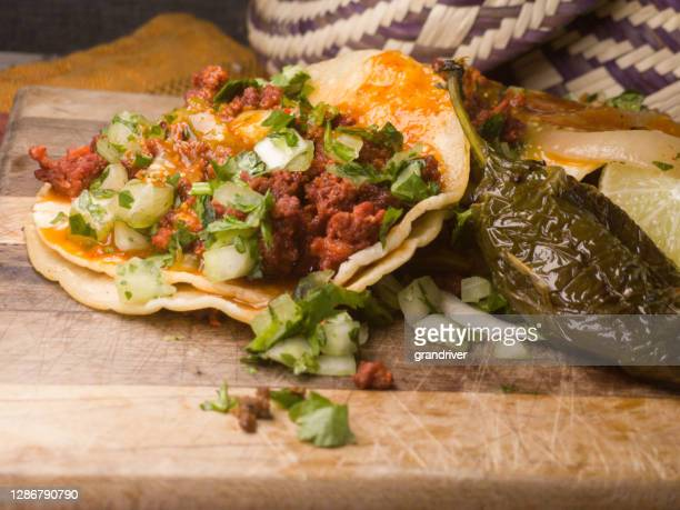 mexican street tacos with chorizo onion cilantro on corn tortillas - chorizo stock pictures, royalty-free photos & images