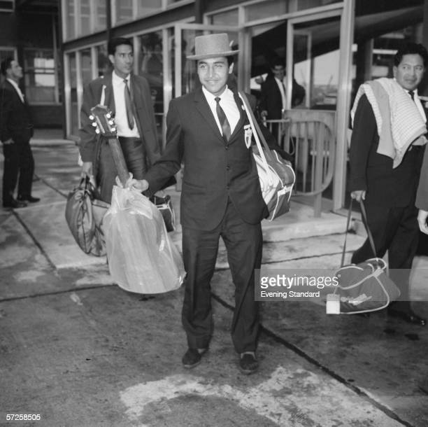Mexican striker Isidoro Diaz, and his guitar, in England during the 1966 World Cup, 25th July 1966.