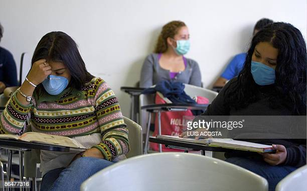 Mexican students attend their class wearing surgical mask at the Faculty of Medicine in the Mexican Auntonomous University in Mexico City on May 7...