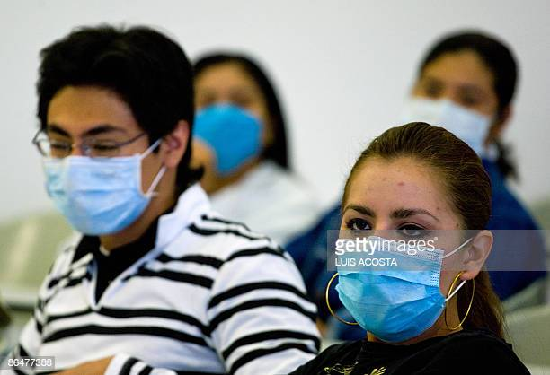 Mexican students attend their class wearing surgical masks at the Faculty of Medicine in the Mexican Autonomous University in Mexico City on May 7...