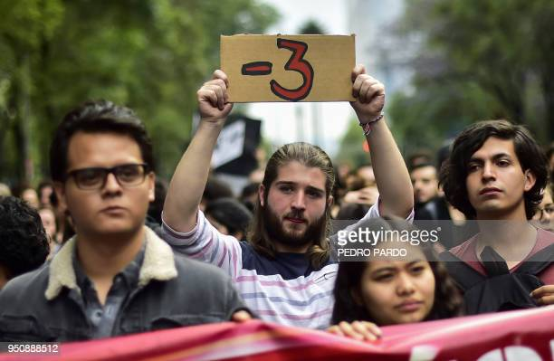 Mexican students take part in a protest against the violence in Mexico and the murder of three students from the University of Audiovisual Media of...