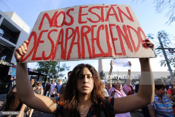 TOPSHOT Mexican students take part in a protest against the violence in Mexico and the murder of three students from the University of Audiovisual...