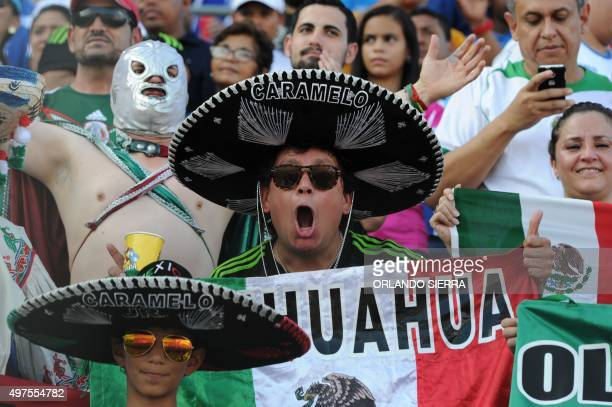 Mexican supporters wait for the start of the Russia 2018 FIFA World Cup Concacaf Qualifiers football match against Honduras in San Pedro Sula on...